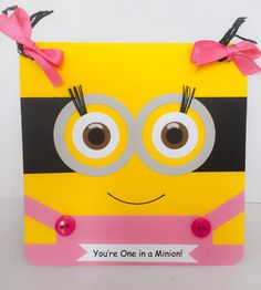 Handmade 2 eyed minion girl greeting card is the perfect way to send a birthday wish to a special girl or minion fan. Pink overalls are embellished