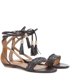 Aquazzura - Sun Valley leather sandals - Aquazzura's 'Sun Valley' sandals come in an understated black hue that is sure to add a luxe finish to any ensemble. Braided ties wrap around the ankle and are finished with metal hardware and dainty tassels. A flat sole makes them ideal for strolling seaside on sun-soaked days. seen @ www.mytheresa.com