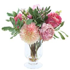 """Faux garden floral arrangement in a clear glass vase.    Product: Faux floral arrangementConstruction Material: Polyester, plastic and glassColor: PinkFeatures: Includes faux blossomsDimensions: 14"""" H x 13"""" DiameterCleaning and Care: Dust with dry cloth"""