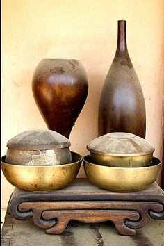 Traditional Korean brass dinnerware and carved serving tray
