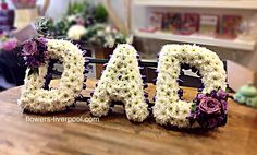 DAD letters in purple and lilac flowers