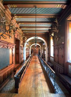 The bowling alley, a favorite space for late-night parties. Love the antler's lining the walls indoor mansion castle bowling alley how amazing