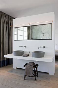 "Put the handles for the water towards the front and make the mirror bigger/ lower.. what a cool double sink that happens to be #accessible but clearly not designed with that first in mind.  Putting a stool under what could be a ""roll under"" sink is a perfect way of preparing for whatever you may need in advance, but designing in the way that meets your style needs now. Comments by Gail Zahtz."