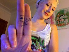 hugging finger tattoos