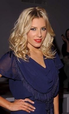 Mollie King: Her bright blonde mid-length hair was styled in a full head of barrel curls with a sexy hint of backcombed volume at the rootshttp://www.hji.co.uk/blogs/celebrity-hair/2012/02/