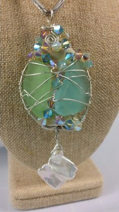 Sea glass / sea pottery caged with sterling silver wire and swarovski crystal with huge pearl dangle. By Jenny Carlile / Divine Jewels.