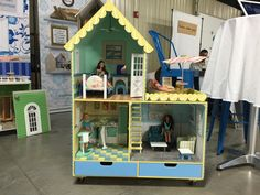 The Cottage at a recent art show. Dollhouse Kits, Branding Iron, Barbie Accessories, Barbie Furniture, Kit Homes, Dollhouses, Toddler Bed, Miniatures, Cottage