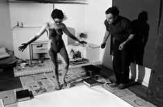"""Rene Burri FRANCE. Paris. 14th arrondissement. Rue Campagne Premiere. French artist Yves KLEIN directing a model in """"body art painting"""". 1961."""