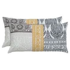 """Cotton pillow with a paisley patchwork motif.  Product: PillowConstruction Material: Cotton coverColor: White and multiFeatures:  Hidden zipper closureMade in IndiaInsert included Dimensions: 11"""" x 21""""Cleaning and Care: Spot clean"""