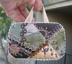 crazy quilt covered Altoid tins