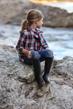 I want this little girl's outfit! Red, green, & white tartan shirt with feminine bow tie; jeans; boots; and casual ponytail.