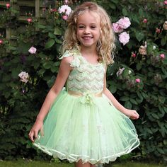 Girls green 'Tinker Bell' party dress from Disney Boutique, is adelicate vintage style dress, with a soft mint green satin sleeveless bodice, overlaid with beautiful gold lace.The 'Tinker Bel'l embroidery embellishes the waist band and is finished off with a petal-inspired corsage and gold-coloured angel wings charm.