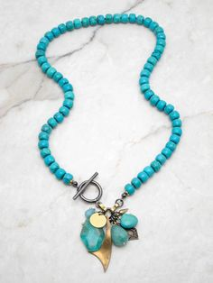 Chunky Turquoise discs with a magnificent charm cluster filled with Apatite, Amazonite, Turquoise, Quartz and vintage brass charms. A new way to wear your bohemian style. ~ Turquoise Howlite Discs ~ Charm Cluster // Apatite/Amazonite/Turquoise/Quartz/Vintage Brass Charms 19 Strand 2