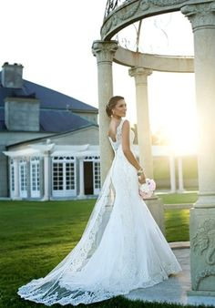 For traditional beauty, this fit and flare designer bridal gown makes the cut. It features a romanti