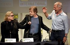 Carrie Fisher Photos Photos - (L-R) Actors Carrie Fisher, Mark Hamill and Harrison Ford pose onstage at the Lucasfilm panel during Comic-Con International 2015 at the San Diego Convention Center on July 10, 2015 in San Diego, California. - Comic-Con International 2015 - Lucasfilm Panel