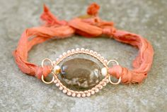 Zebra Jasper and Peach Glass Coral Pink Silk Sari Wire Wrap Bracelet. $18.00, via Etsy.
