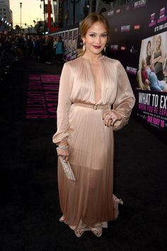 Jennifer Lopez Evening Dress  Jennifer Lopez looked divine at the 'What to Expect When You're Expecting Premiere' wearing this silky nude gown.  Brand: Maria Lucia Hohan