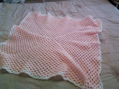 Peach and white blankie made by mum