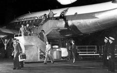 Passengers disembarking from a late night flight at Jan Smuts airport outside Johannesburg. Passenger Aircraft, Late Nights, Constellations, South Africa, Aviation, Nostalgia, Plane, Commercial, Wings