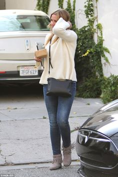 Actress Cameron Diaz steps out in comfort and style in the Minnetonka Hi Top Back Zip Boot.