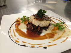 """Our Chef's Tables guests and chef come up with the best flavor combinations! Here we have truffle """"scales"""" with Chilean sea bass, wild mushroom sautée, and lobster truffle sauce over jumbo crab ravioli.."""