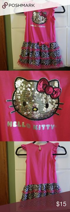 Hello Kitty size 6 sequins Embelished zebra print This hello Kitty size 6 dress is in good used condition it features an application that is sequins and is hello Kitty is face there's also screen printed hello Kitty name underneath it has a zebra print skirt and a bow on the front It is 60% cotton 36% polyester and 4% spandex Hello Kitty Dresses