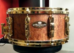Pearl Masterworks snare with gold lugs and hoops