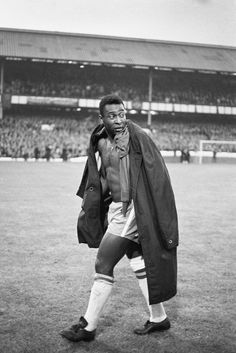 An injured Pele of Brazil trudges off as his side lose to Portugal 3-1 during the 1966 World Cup