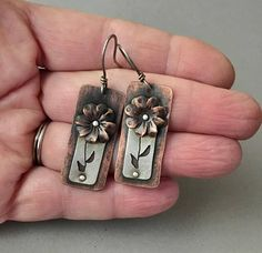 Mixed metal floral earrings, riveted flower earrings, silver and copper textured earrings. Cute handmade copper flower cup with silhouette stem and leaves. I handcrafted these light weight earrings from flat sheet metals by cutting the shape, forming and texturing the flower. The stem