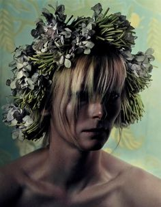 Tilda Swinton looking like a hot mess wonderful dying fairy.....love her.....She has a very Androgynous Ethereal look