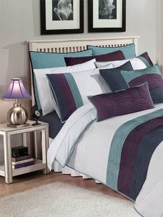 Aroma (8 Piece) Quilt Cover Set - Revamp your bedroom with Aroma Quilt cover set and make your room look Elegant with this simple looking compatible pin tucks in navy, teal and plum color that enhances the look of your room.