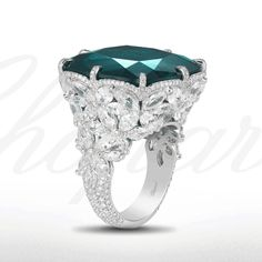 An exquisite ring from the Red Carpet Collection with a cushion-shaped emerald set within a meadow of diamond flowers.