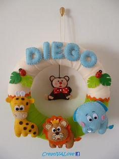 Ghirlanda/fiocco nascita con animaletti della savana: giraffa, leone, elefante, scimmia in pannolenci/feltro. Handmade Felt Creations.