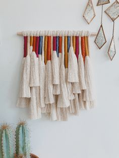 A macrame wall hanging made with fine combed cotton rope and cotton thread creates a unique work of modern boho art. This colorful woven wall hanging is a beautiful piece of art for a living room, above a bed, in a hallway, or even in a kids bedroom. Macrame Wall Hanging Diy, Macrame Art, Macrame Projects, Macrame Thread, Hanging Art, Hanging Beds, Hanging Chairs, Art Macramé, Yarn Wall Art