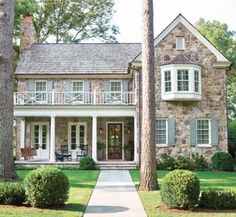 I love stone houses.  And front porches.  And window seats.  And balconies.  Sigh.