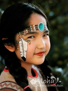 Indian princess face painting. Why don't we just paint her face black and put a bandana on her head and call her Aunt Jemima?!?