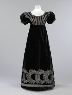 V&A Museum  item no T.73-2010. Mourning silk velvet eve dress, Scotland, decorated with silk satin piping&appliqué 1823-25.