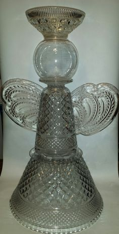 """28"""" Glass angel I made from punch bowls, vases, light globes and candy dishes."""