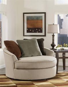 Signature Design By Ashley   Oversized Round Swivel Chair