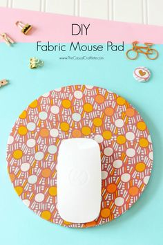 Create a custom mouse pad with just a few inexpensive supplies and easy steps.  This DIY Fabric Mouse Pad will bring tons of color and function to your office space.