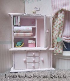Miniature dollhouse shabby chic pink with rose print hutch 1:12 scale.  via Etsy.