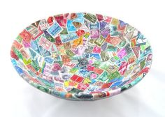 """POSTAGE STAMP BOWL"" by 'BOMBUS' This is a hand decoupaged bowl using a collection of old stamps from all over the world. http://www.etsy.com/shop/Bombus?ref=pr_shop#"