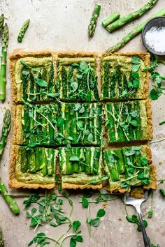 This gorgeous Vegan Ricotta and Asparagus Tart has a gluten free cornmeal crust. It's a great vegan/vegetarian spring appetizer and the perfect way to use up all of the asparagus you bought this week! The vegan ricotta filling is made with macadamia nuts, cashews and plenty of fresh herbs. #vegan #asparagustart #glutenfree   crowdedkitchen.com