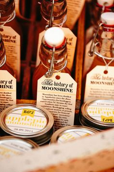 Southern style moonshine favors that include custom tags highlighting the history of the spirit and personalized labels with the bride and groom's monogram and date of the event.