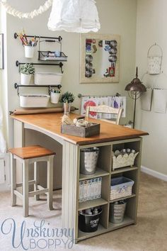 Make a craft table with a countertop mounted to bookcases, add trim and breadboard wallpaper to sides of bookcases