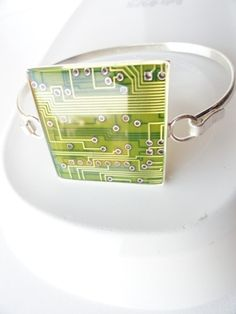 If your color is green, you'll love this lemon lime square bracelet. In the sun light, it reflects the lemon colored leads(actually copper) under the lime colored motherboard. MEMBER - GMOTHERBORED