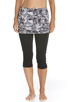 """Want leg coverage but not 100% sold on our tights? Our Skirted Swim Capris have a contoured athletic fit and ruche skirt top sure to flatter your figure. Made of our aqua SUNTECT® that""""s quick to dry and chlorine/salt resistant, this capri works on land or in water. Grip elastic in back prevents back from slipping. We've added a pocket inside the front for keys too."""