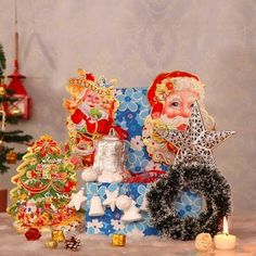 Send Christmas Decor Online with same day delivery in Ahmedabad from SendGifts Ahmedabad. Order Christmas Decor online and express your best feeling to your Special Person. Merry Christmas, Christmas Gifts, Christmas Decorations, Paper Wall Hanging, White Wreath, Silver Tops, Ahmedabad, Santa, Wreaths