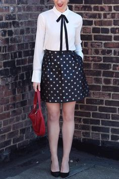 Loving this festive look from Linen Lace and Love. She pairs our black and white contrast tie-front blouse with a black and silver polka-dot skirt | Banana Republic