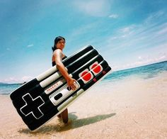 Show off your fantasy for retro 80's games by chilling on this Retro Gamers Controller Pool Float this summer.